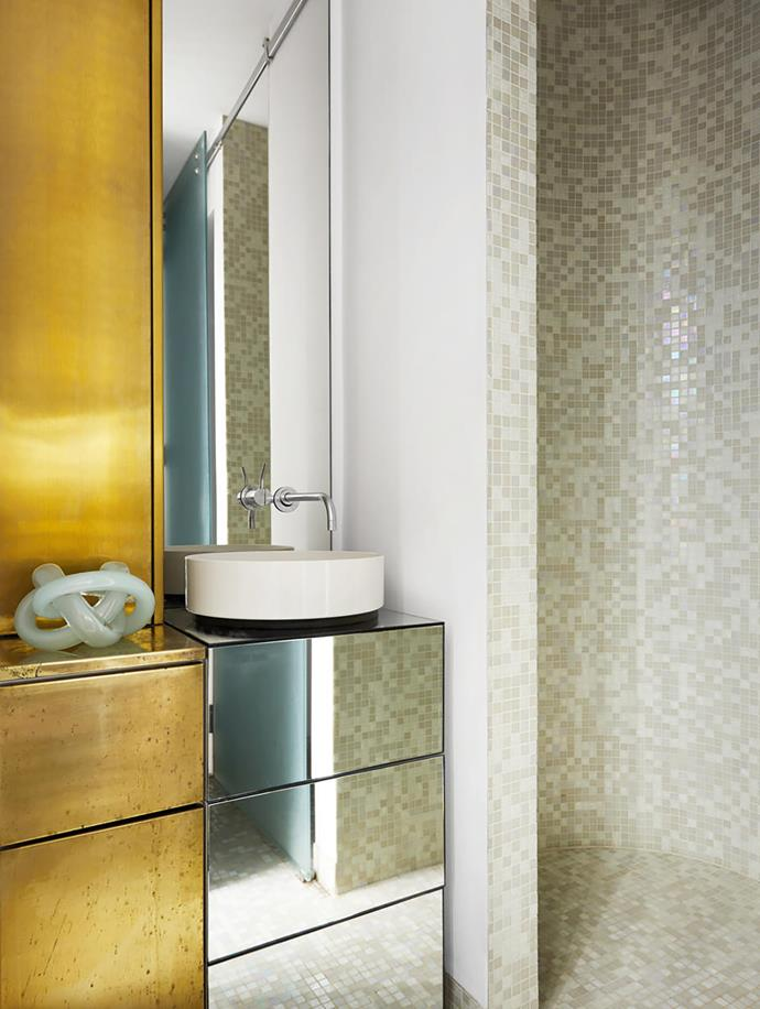The brass theme continues here with a custom vanity by Seventy7 Projects. Tiles, Bisazza. Vola tapware.