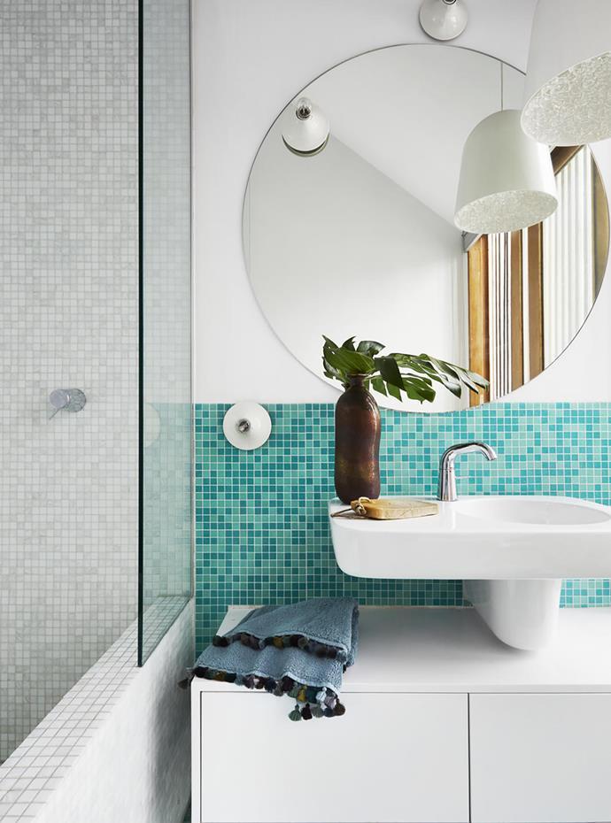Bisazza 'Bahamas' glass mosaic tiles create a fresh splashback. Marc Newson basin and vanity, both from Caroma. Astra Walker tapware. Custom mirror.