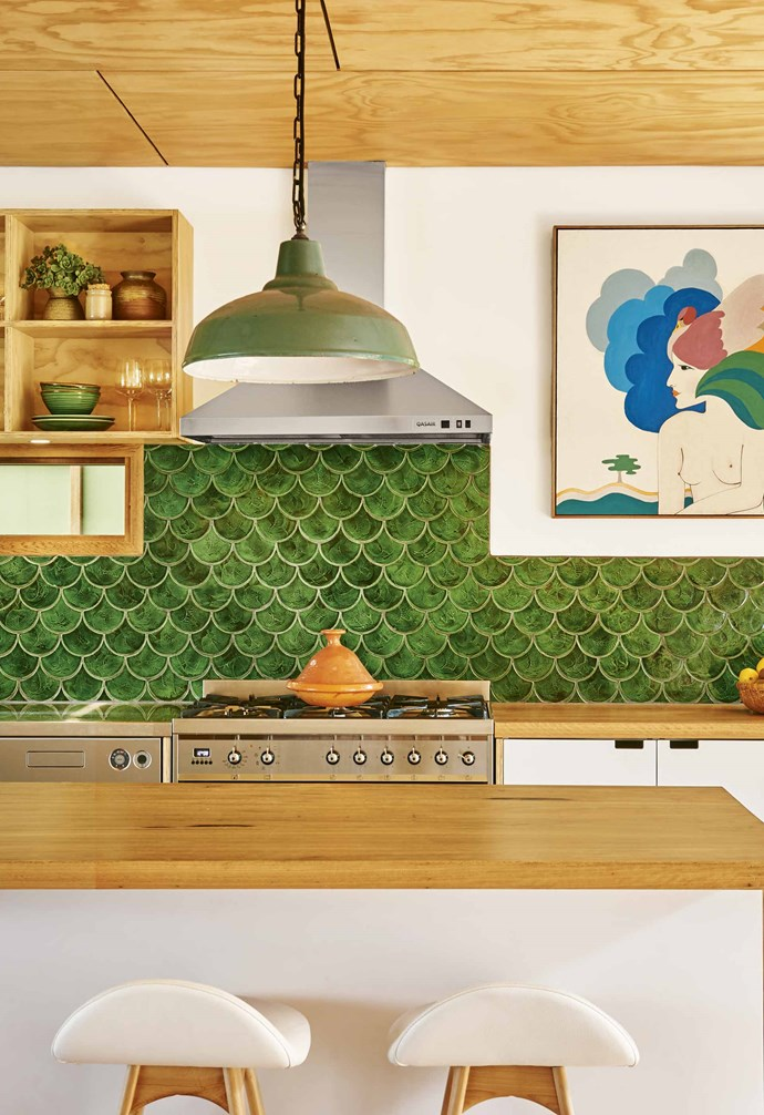 "Sarah loves to decorate with elements that have meaning, like the art piece in the kitchen. ""It is a 1960s hand-painted scarf that was handed down from my mother, which I stretched into a frame,"" she says. The lush emerald-green tiles, sourced from [The Pug Mill](https://www.pugmill.com.au/