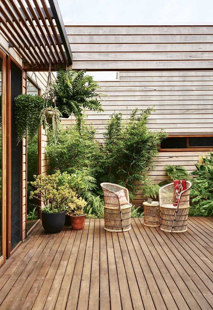 "The home is anchored by four [decks](https://www.homestolove.com.au/balcony-and-deck-design-ideas-2458|target=""_blank""), each positioned to make the most of the sunlight. ""The decks open up the home to the outside and bring the green in,"" says Sarah. The silvertop ash decking and cladding have been finished with Cutek 'CD50' protective oil. This [entry garden](https://www.homestolove.com.au/enviable-entry-gardens-17367