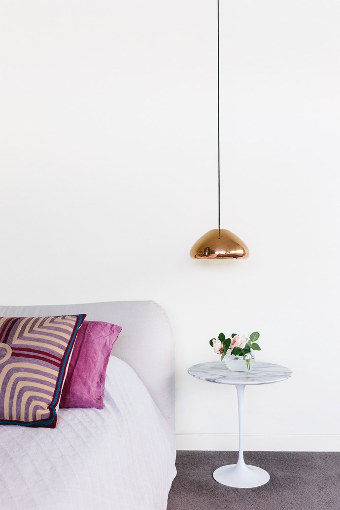 "A Tom Dixon 'Void' pendant light hangs over the Knoll Studio 'Saarinen Tulip' side table from [Dedece](http://dedece.com/|target=""_blank""