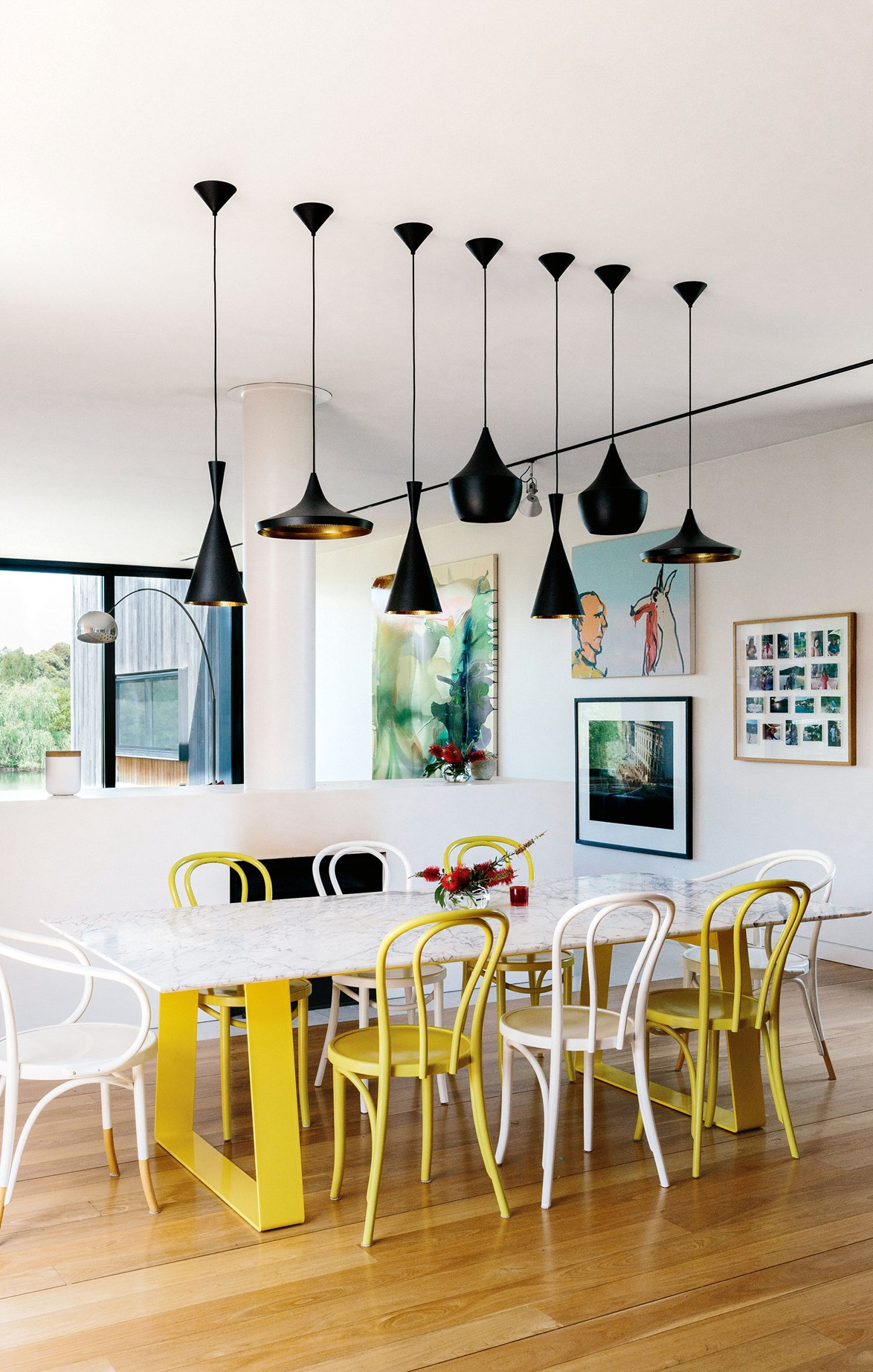 'No.B9 Le Corbusier' and 'No. 18 Thonet' chairs in alternating white and yellow make a colourful statement.