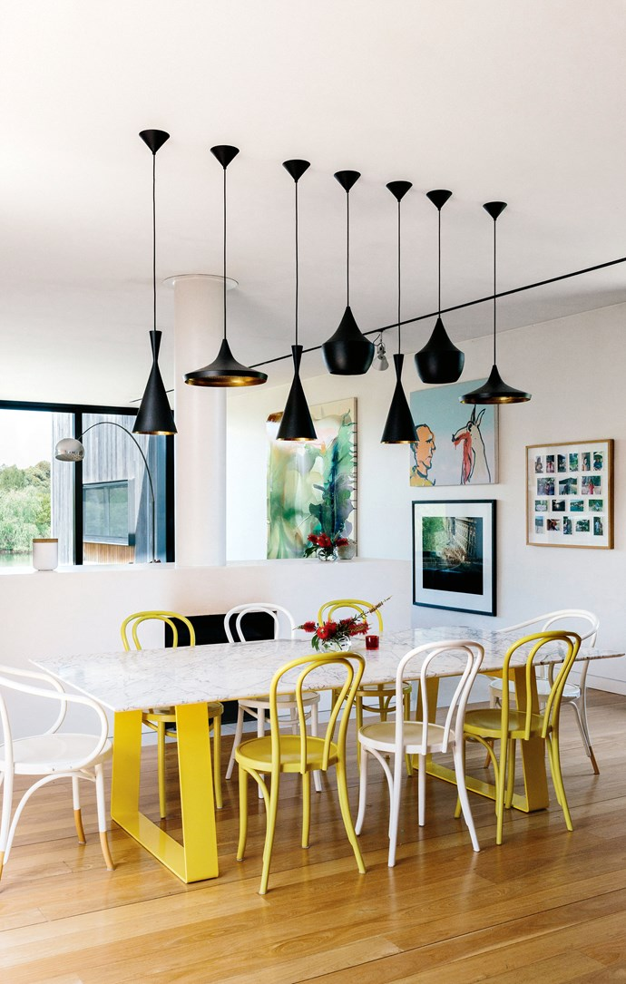 A 'Horizon' table designed by Chris Connell takes centre stage in the dining room, surrounded by 'No.B9 Le Corbusier' and 'No. 18 Thonet' chairs from Thonet. Tom Dixon pendant lights hang above the table.