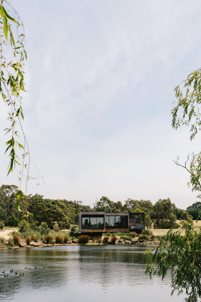 """""""It was all about the house being a vehicle to experience the landscape,"""" says Imogen of the design. """"The house itself is terribly simple with high ceilings and full sliding windows and doors to let the breeze come through. It's clad in certified rainforest teak and the long-term plan is for it to weather the colour of the gum trees and sink down into the landscape."""""""