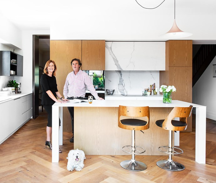 """The existing floor was replaced for consistency,"" says architect Jane Riddell who, in conjunction with owner Hugh (both pictured, with West Highland terrier Fergus), chose Grande oak floorboards in Chamoisee from Tongue N Groove. Other materials include Dekton in Zenith (island bench), Statuario marble (splashback) and Eveneer timber veneer in Almond (cabinetry throughout). V-Zug induction cooktop and wall oven. Gaggia coffee machine."