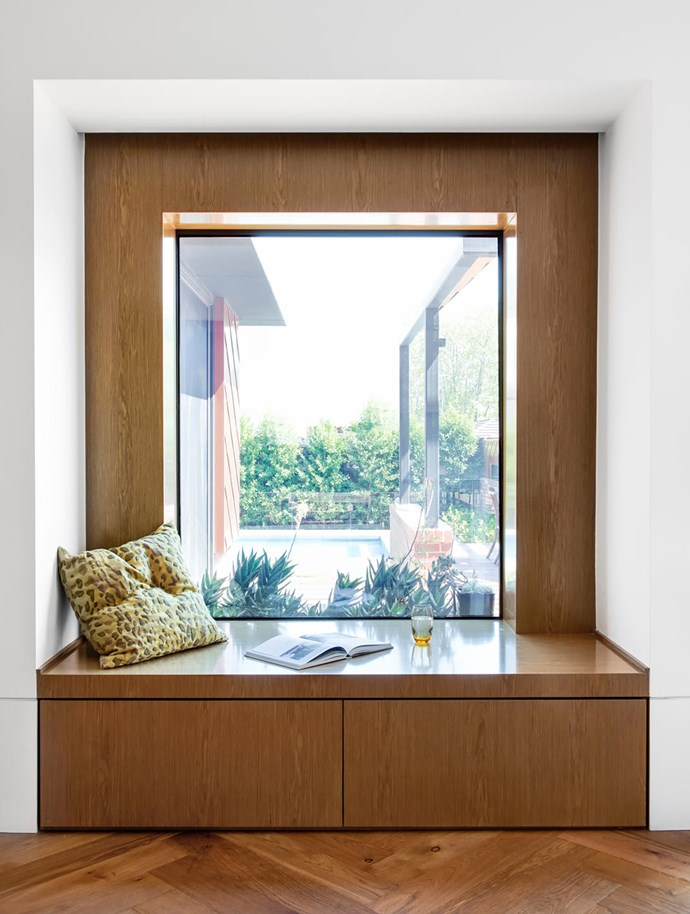 In line with the front door and framing the view of the garden is a stylish bench seat and storage unit, also made from Eveneer timber veneer in Almond. Its height is intentionally close to that of Hugh's credenza.