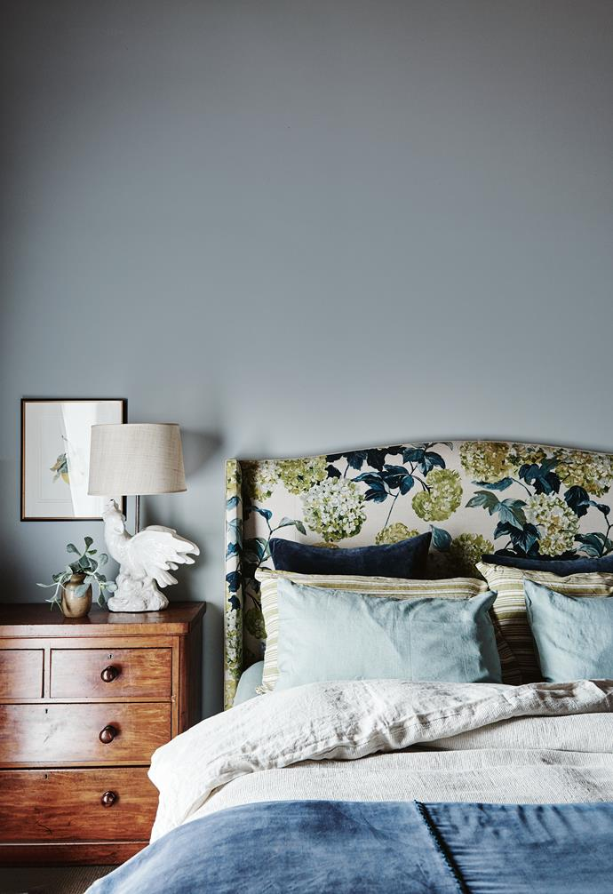 "In the main bedroom, the wingback bedhead is 'Hampton' by Heatherly Design, and is covered in Designers Guild 'Cassandra' hydrangea-print linen. ""In decorating, so much is Scandinavian and pared back now and that's beautiful. But I'm a fabric girl — this is what I love,"" says Georgie."