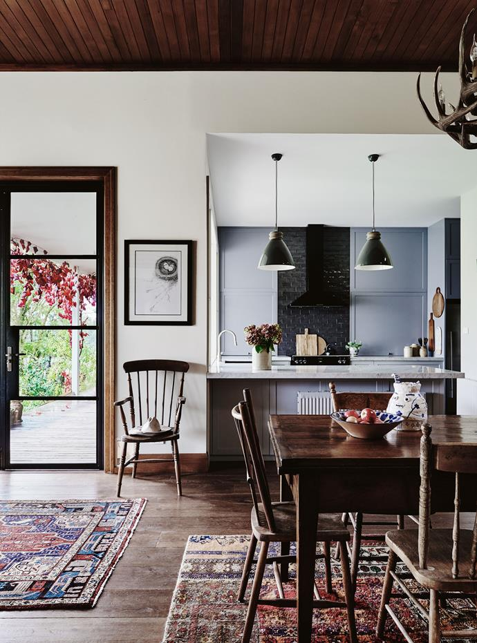The new kitchen adjoins the living areas, and features pendant lights from Schots Home Emporium and Carrara marble benchtops from Baltic Stonemason Professionals. Hanging above the Shaker chair is a drawing by Victorian artist Darren Gilbert. The dining table is a favourite.