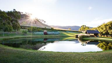 A Victorian flower garden with its own private lake