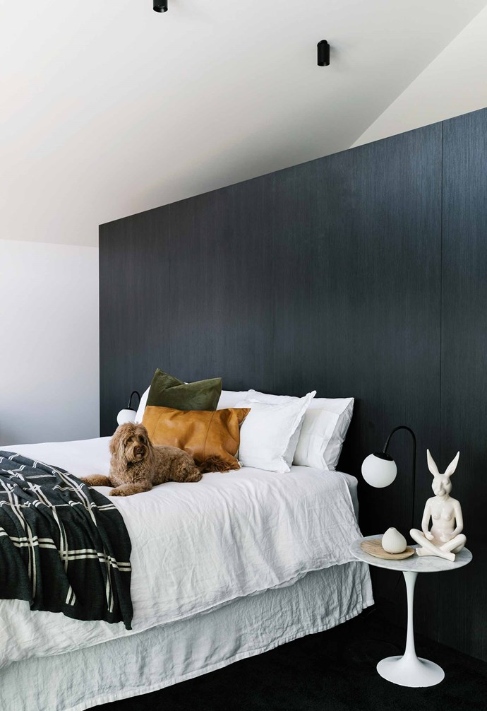"""**Master bedroom** The black 'wall' is actually the reverse of the walk-in robe and houses the air conditioning. Minimal decor in the rest of the space lets the view take centre stage. Carpet, [Choices Flooring](https://www.choicesflooring.com.au/