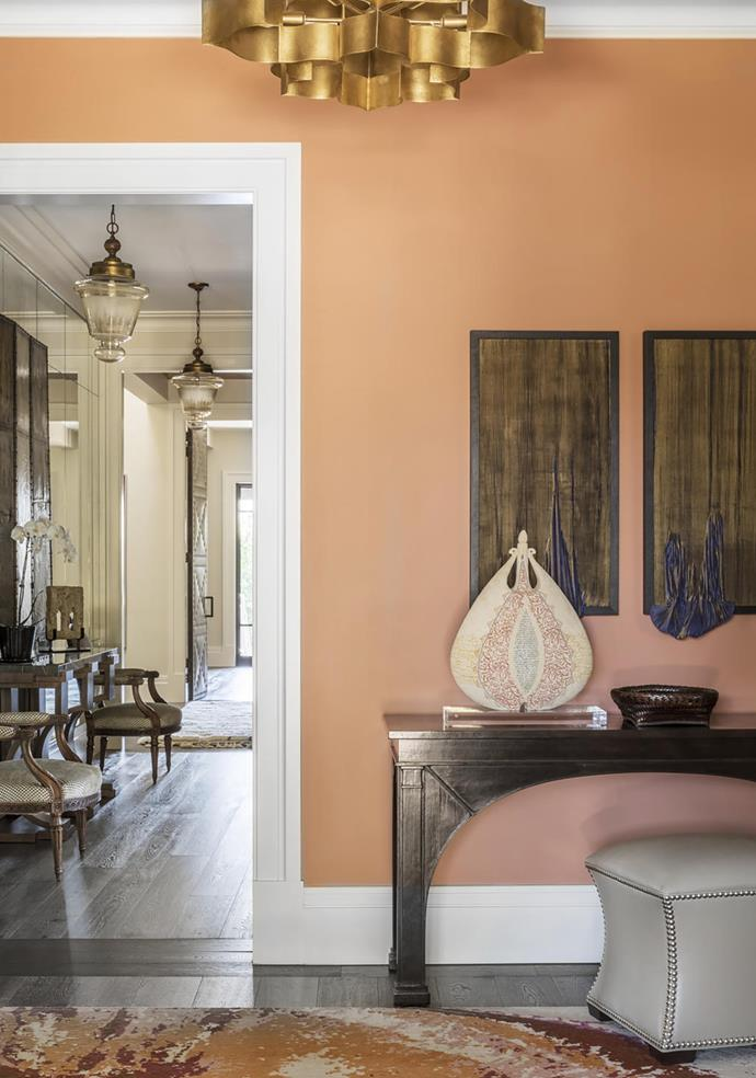 In the entry, 'Fontaine' console from Gregorius Pineo. Vessel on console by Avital Sheffer from Artvisory Gallery. 'Eclipse' ottoman and 'Grand Lotus' chandelier, both from Cromwell. Works above console by Stevie Fieldsend from Artereal Gallery. Walls in Dulux 'Terracotta Chip'.