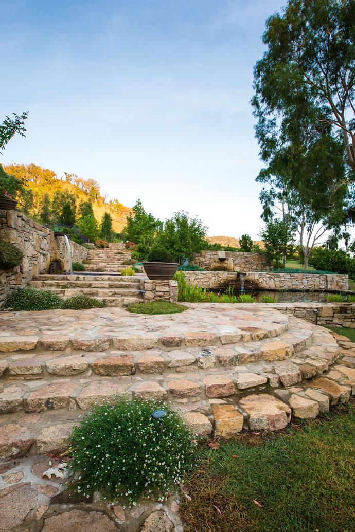 Local stonemason, Howard Mitchell, collected the granite fieldstones on the property and spent two years constructing the stone stairs and walls.