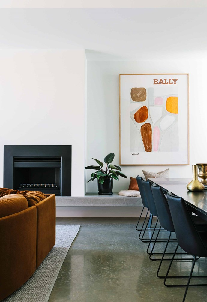 """**Living and dining area** A key to the success of this reno is how Myer used complementary and contrasting shades in the furniture to add warmth and texture. An inviting rust sofa was a vintage find, while the 'Barnes' dining table is from [GlobeWest](https://www.globewest.com.au/
