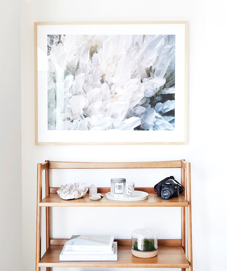 A statement artwork and a small set of shelves is all you need to bring a bare entryway to life. We'd be happy to come home to this magical display everyday!