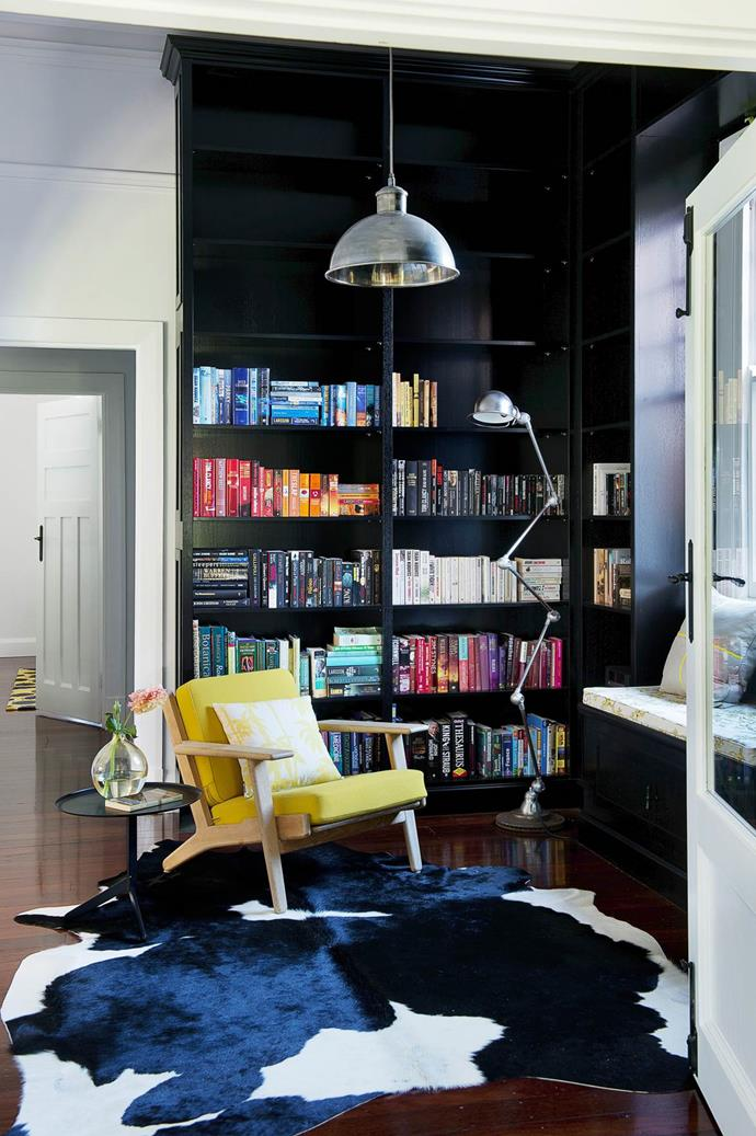 "In the library of this [modernised Federation home](https://www.homestolove.com.au/gallery-tiffany-and-gavins-federation-house-extension-1804|target=""_blank""), black japan finishes create a dark, restful retreat. Joinery by Subiaco Furniture Factory. Armchair and rug, both from Grandfather's Axe. *Photography*: Jody D'Arcy 