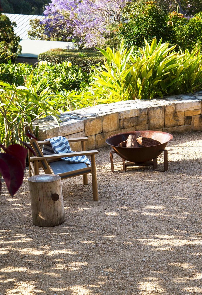 """**Front garden** A landing halfway up the stepped slope provides a place to stop and admire the view. 'Hunter' chair, [Eco Outdoor](https://www.ecooutdoor.com.au/