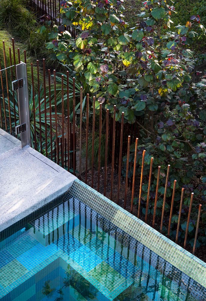 **Side garden** Untreated steel fence rods frame the pool area.