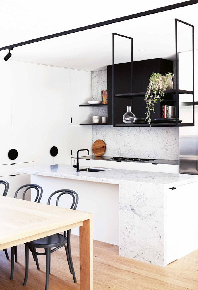 """""""The block is half the size of what we had before but it fits more house on it. It doesn't feel like a poky little townhouse – none of the spaces are unusually small – but in saying that it also doesn't take long to get from A to B!""""<br><br>**Kitchen** Carrara marble is used on the [benchtops](https://www.homestolove.com.au/kitchen-benchtop-guide-19237