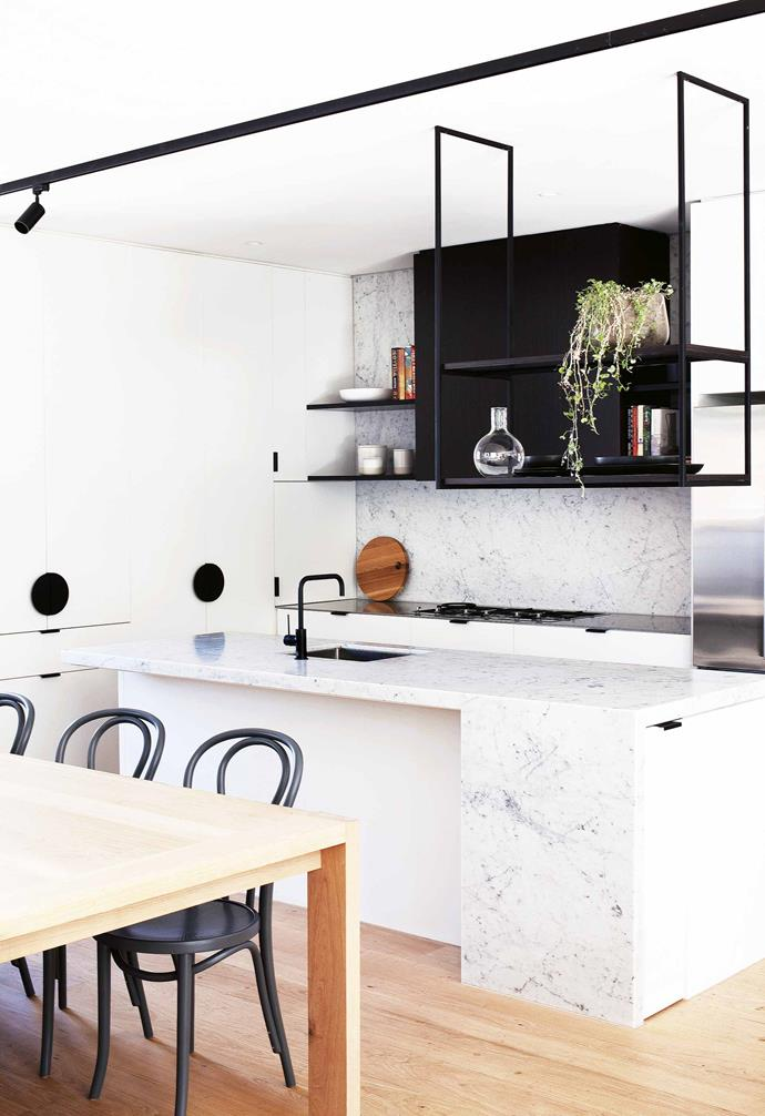 """The block is half the size of what we had before but it fits more house on it. It doesn't feel like a poky little townhouse – none of the spaces are unusually small – but in saying that it also doesn't take long to get from A to B!""<br><br>**Kitchen** Carrara marble is used on the [benchtops](https://www.homestolove.com.au/kitchen-benchtop-guide-19237