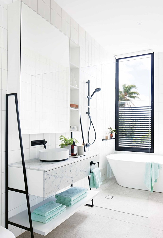 """**How long did it take you to work out how to use the space?** The design process took about three years – it took this long because it was my own house and I worked on it after hours. Once it got going, the planning stage took about nine months.<br><br>**Bathroom** """"The tiles have been laid vertically, which makes the dominant lines in the space vertical,"""" says George of the wall tiles from [Classic Ceramics](http://brochures.classicceramics.net/