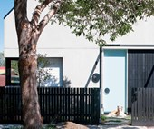 A clever subdivision created a pair of family-friendly modern townhouses