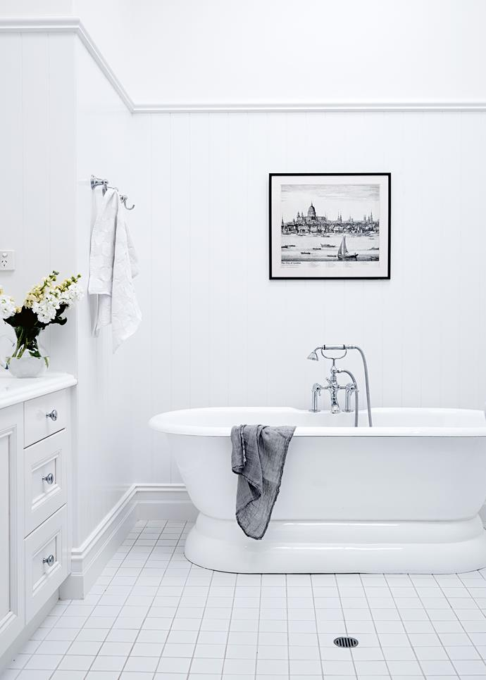 White walls and floors light up the classic English-style bathroom.