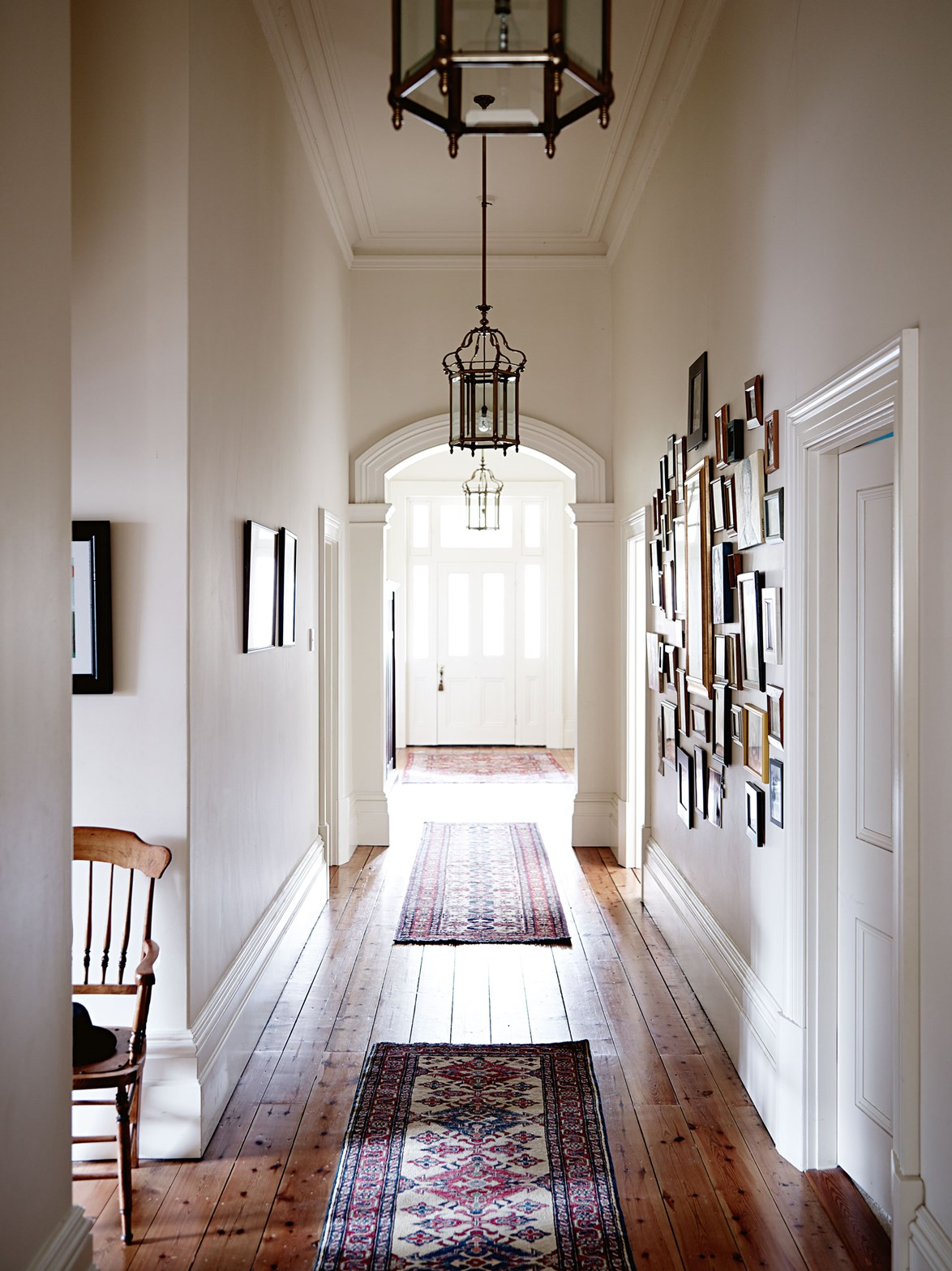 "Sunlight streams into the wide entrance hallway of a [classic contemporary homestead](https://www.homestolove.com.au/classic-contemporary-homestead-13411|target=""_blank"") in the Adelaide Hills, which was painted an airy-shade of off-white to draw attention to the hone's high ceilings and original features."