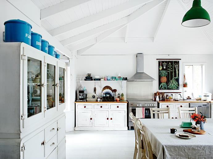 """I love being surrounded by collected treasures that tell a story,"" says Rachel of her kitchen. Despite living 250 kilometres away in Perth, Craig and Rachel spent 10 weekends travelling down to work on the house before moving in; transforming dark jarrah and varnished pine with [white paint](https://www.homestolove.com.au/how-to-pick-the-right-white-paint-for-your-home-3741