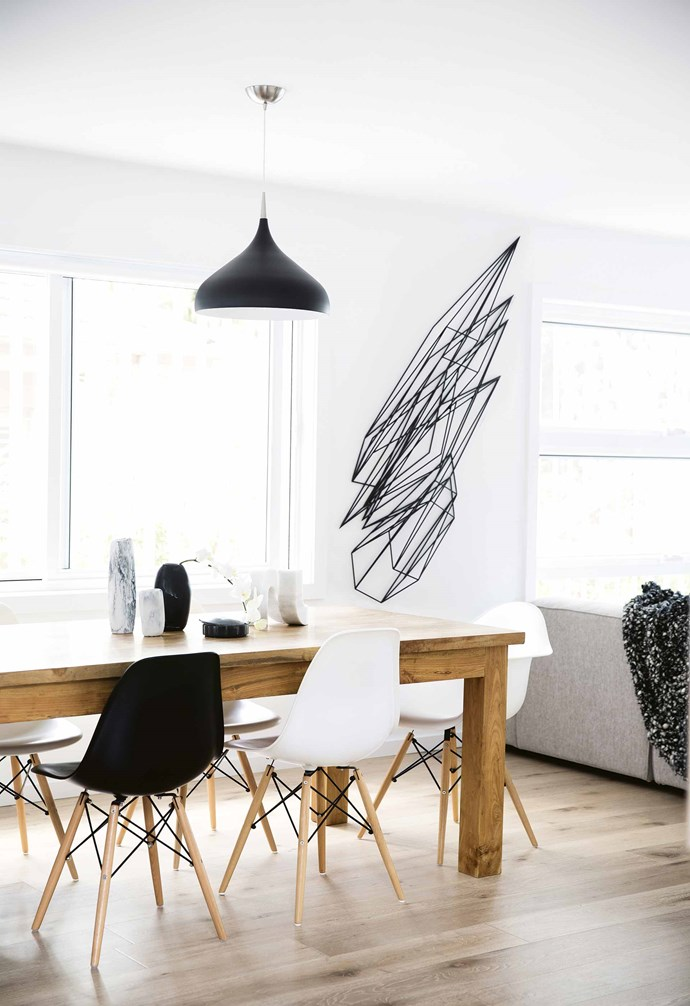 "This plays out with white walls, bold lighting and other star furniture items in black. The [white kitchen](https://www.homestolove.com.au/best-white-kitchens-17040|target=""_blank"") has also been broken up with dollops of black. ""As we were building it we thought it might look very stark, so we decided instead to go for black cabinetry for the pantry and internal laundry,"" says Sophie. It's now Dean's favourite part of the house. ""I love the black on the cupboards. It makes that working area disappear,"" he says.<br><br>**Artwork** A commissioned sculpture by artist [Dion Horstmans](http://dionhorstmans.com/