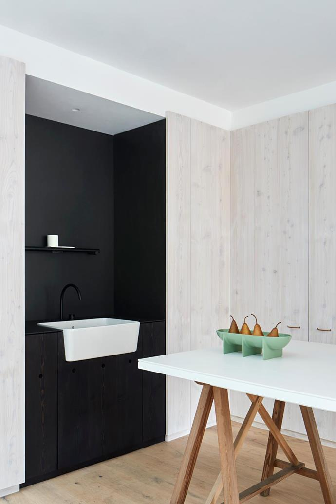 Benchtop/island bench Honed Artetech 6mm porcelain tiles in Essenza Antico by Artedomus. Flooring Oak boards by Admonter Australia. Sink Galdor Farmers double-glazed ceramic butler sink in White from Turner Hastings. Tapware Vola '590HM' mixer in Matt Black from Mary Noall.