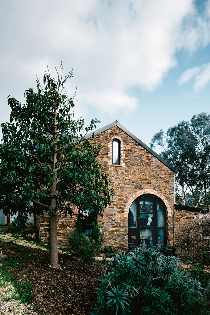 """Built of solid stone in the 1870s as a bacon factory, Factoria V11 is now a serene country home for owners, Alia Elaraj and Scout Edwards. They had been searching for a place to call home; a place where they could bring up their sons, Oliver, 10, and Arlo, four, with respect for the natural environment and with an appreciation of old fashioned values, when they came across this [grand industrial building](https://www.homestolove.com.au/warehouse-sydney-home-19821
