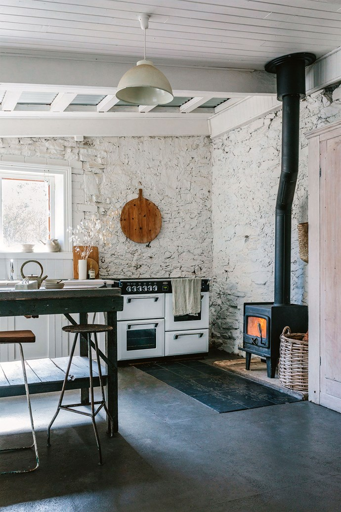 """The industrial bench in the kitchen is a nod to the history of the building. Alia and Scout decided to call their new five-bedroom home Factoria V11, reflecting its industrial heritage. It had been [converted to a home](https://www.homestolove.com.au/home-conversion-ideas-19765