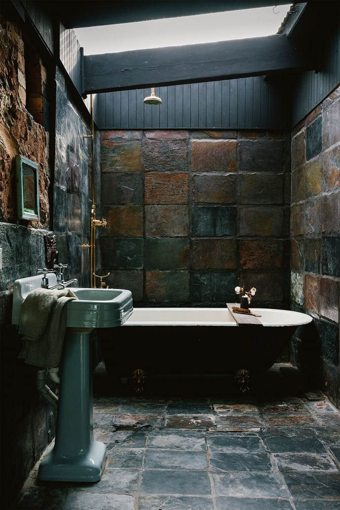 """One of the two bathrooms is [tiled in slate](https://www.homestolove.com.au/buyers-guide-to-hard-flooring-16333