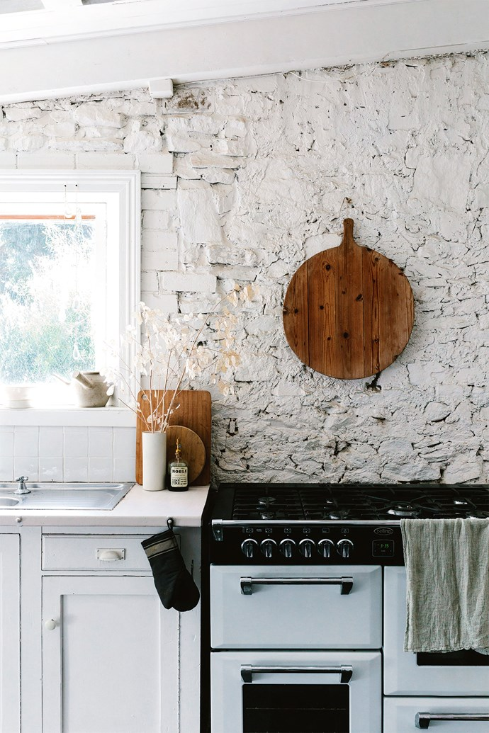 In the kitchen, timber cupboards are painted white and the cook is well equipped with a Belling 'Richmond' seven-burner gas cooktop and electric oven in white.