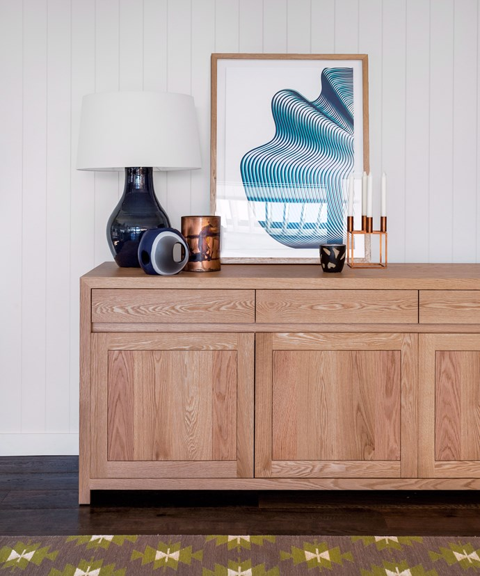 As well as providing additional storage, a sideboard creates a place to display artwork and other treasures. *Photo:* Felix Forest