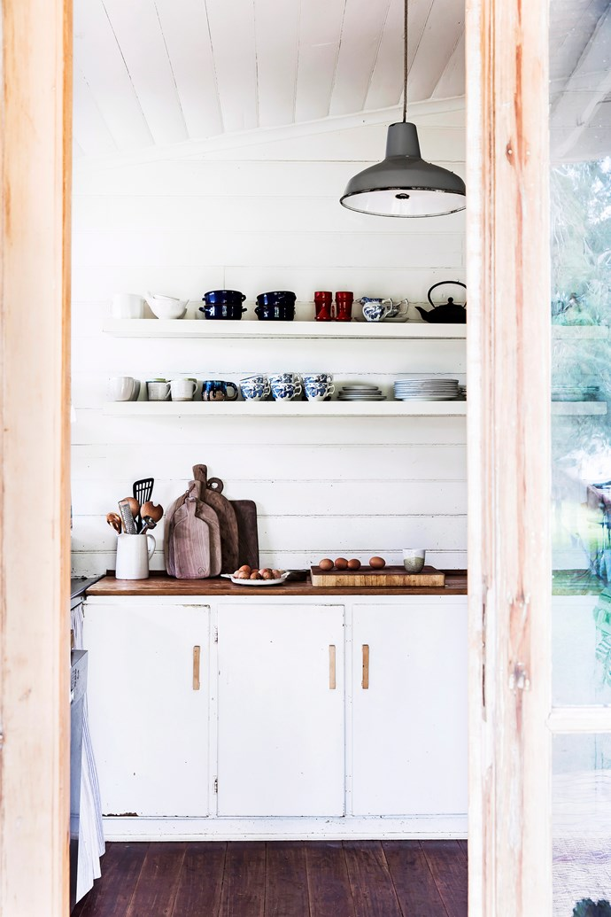 Floating shelves are especially handy in the kitchen, providing extra storage space as well as a place to display your most-loved or most-used servingware. *Photo:* Maree Homer