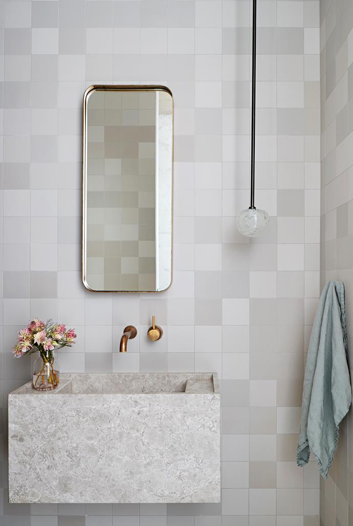 This bathroom by Robson Rak features Italian Mutina tiles, Astra Walker taps and a basin hewn from limestone. Smart tech: Grohe 'SmartControl' exposed shower. *Photo*: Shannon McGrath
