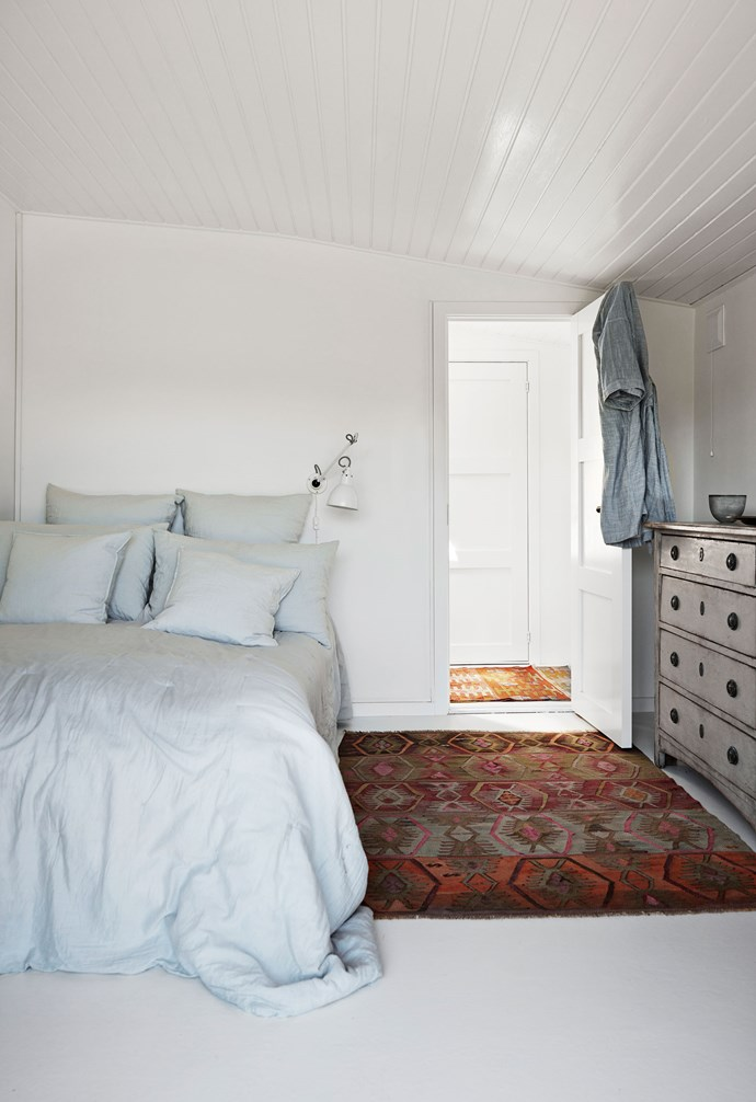 """The master bedroom features light blue bed linen. """"One of the best things we've done to the place is open it up and create more fluid transitions between the various functions of the house,"""" says Jette. """"I've also tried to get as much light into the house as possible, which is something I aim for in every project I undertake."""""""