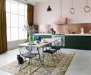 A former factory is now a colourful industrial home with mid-century modern style