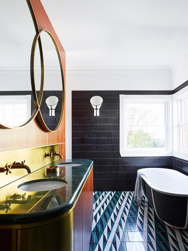 "The brief for this apartment was a [Latin-inspired rejuvenation](https://www.homestolove.com.au/makeover-of-an-art-deco-apartment-in-bondi-6291|target=""_blank"") of the original art deco features with bold, geometric ceramics, warm timbers, raw brass detailing and custom terrazzo. 'Backgammon' bathroom floor tiles by Gio Ponti with Inax 'Yuki Border' wall tiles from Artedomus. Designheure 'Baby Cargo' wall lights. *Photograph*: Anson Smart 