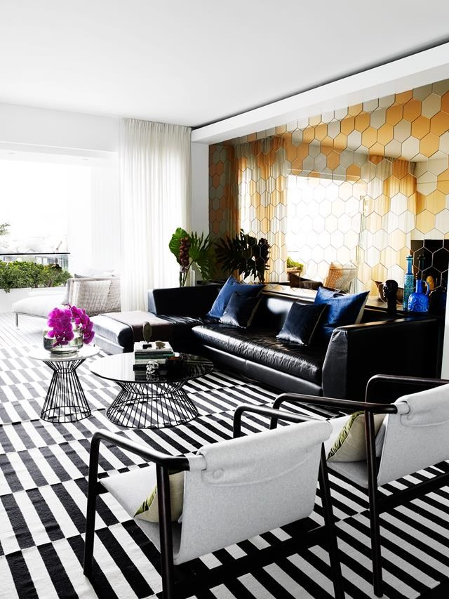 Interior designer Michelle Macarounas coaxed this dilapidated Art Deco property back to a modern design. Michelle installed the wall art of mixed hexagonal tiles to bring the ocean view inside. The striped rug is from Hali. *Photograph*: Prue Ruscoe. | *Belle*
