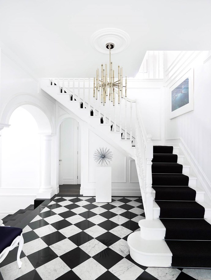 "The imposing entry sets the scene for the whole house. The [Greg Natale interiors](https://www.homestolove.com.au/gallery-emma-and-tonis-luxurious-regency-style-home-2311|target=""_blank"") are a blend of different styles, but Hollywood Regency is the predominant one. *Photograph*: Anson Smart 