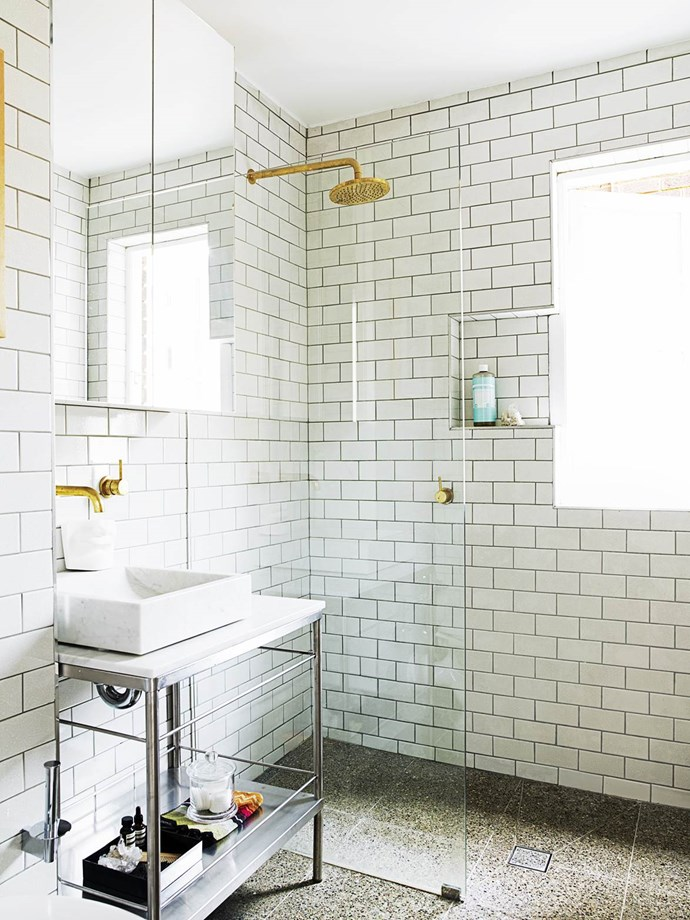 "A [two-bedroom Art Deco apartment](https://www.homestolove.com.au/gallery-dinas-art-deco-sydney-apartment-reno-1497|target=""_blank"") in Sydney's Inner East provided the perfect canvas for interior designer Dina Broadhurst to practise her art. In the bathroom, Dina had a hospital trolley repurposed as a vanity – the top was replaced with a marble slab. The bathroom's matt brass fittings are a favourite of Dina's. *Photograph*: Prue Ruscoe 