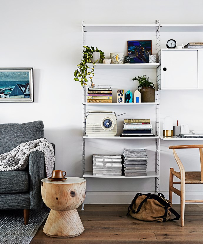 Simple yet stylish shelving systems like this not only provide extra storage but a place to display  decor, books and indoor plants. *Photo:* Sharyn Cairns / *bauersyndication.com.au*