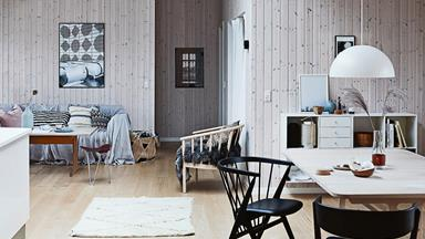 A blonde timber cabin on the Danish coastline