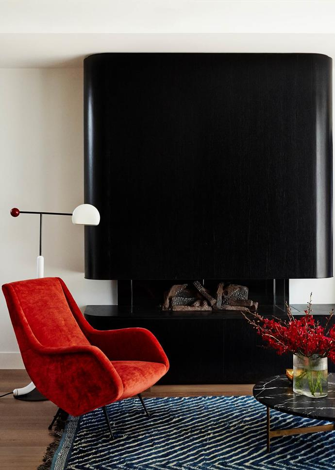 "The living room of this [South Yarra pad](https://www.homestolove.com.au/high-end-pad-in-south-yarra-19733|target=""_blank"") designed by Full of Grace Interiors features an Aldo Morbelli armchair from Atlas Gallery. *Photograph*: Fiona Storey. From *Belle* February/March 2019."