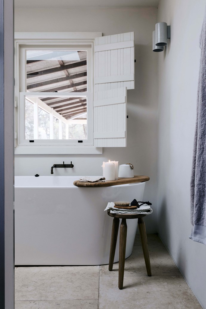 """Felicity Slattery of [Studio Esteta](https://www.homestolove.com.au/emerging-interior-design-stars-studio-esteta-6789 target=""""_blank"""") completed the interior renovation, including enlarging the bathroom for the must-have bath. The talented builders from Pirie Homes custom-made the shutters, which were inspired by a holiday Edwina took to Greece."""