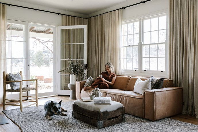 """Edwina relaxing on a leather sofa from [Spence and Lyda](https://www.spenceandlyda.com.au/ target=""""_blank"""" rel=""""nofollow""""). The cushions and ottoman were made from fabric purchased at a market in Japan."""