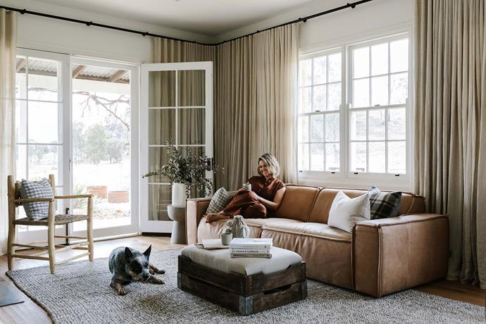 "Edwina relaxing on a leather sofa from [Spence and Lyda](https://www.spenceandlyda.com.au/|target=""_blank""
