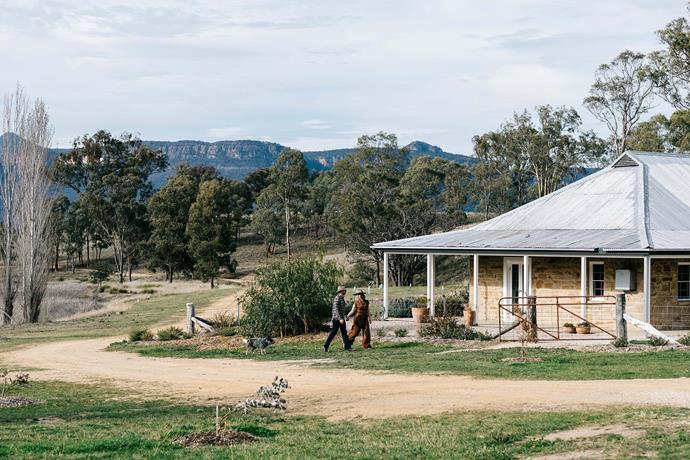Edwina Bartholomew and Neil Varcoe, along with blue heeler Mate, at their 1890s sandstone farmhouse in rural NSW.